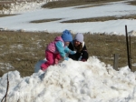 Zo + Hope climb a snowpile--in mid-April!